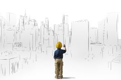 Ambition of a young architect. Big ambition of a young architect Royalty Free Stock Images