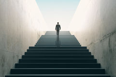 Ambitions concept with businessman climbing stairs Royalty Free Stock Images
