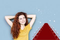 Ambitious amateur actress smiling and dreaming of becoming famous. Future celebrity. Cheerful optimistic amateur actress feeling happy while dreaming about royalty free stock images