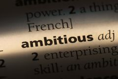 Ambitious. Word in a dictionary.  concept stock photos