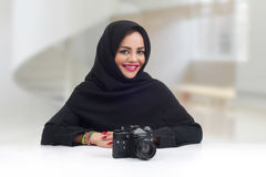 Ambitious Arabian photographer posing with her professional camera Stock Images