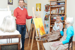 Ambitious artist lecturing in painting school. Royalty Free Stock Photos