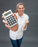 Ambitious beautiful young woman smiling and acting victorious, winning jackpot Stock Photography