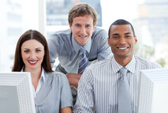 Ambitious business group working at a computer Royalty Free Stock Image
