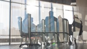 Ambitious business people discussion the project. Behind the glass wall. Partnership stock video footage