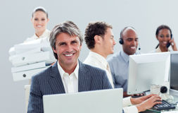 Ambitious business team working hard Royalty Free Stock Photo