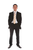 Ambitious businessman. An ambitious businessman standing in front of a white background stock image