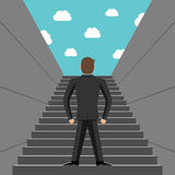 Ambitious businessman climbing steps Stock Image