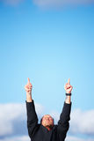 Ambitious businessman pointing upwards Stock Photos