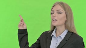 Ambitious businesswoman giving presentation against chroma key stock video