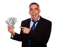 Ambitious executive holding cash money stock photo