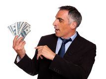 Ambitious executive looking dollars Stock Image