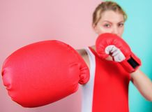 Ambitious girl fight boxing gloves. Female rights. I am gonna kick you off. Confident in her boxing skill. Boxing. Improve temper and will. Concentrated on royalty free stock images