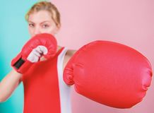 Ambitious girl fight boxing gloves. Female rights. I am gonna kick you off. Confident in her boxing skill. Boxing. Improve temper and will. Concentrated on stock photo