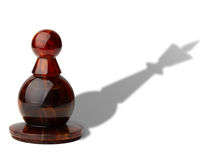 Ambitious goal. Chess pawn with king's shadow isolated on white background, clipping path included Stock Photography