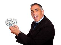 Ambitious latin executive holding cash money Stock Photo