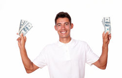 Ambitious man smiling with cash on hands. Stock Photos