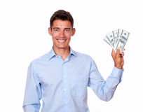 Ambitious man smiling and holding cash dollars Royalty Free Stock Image