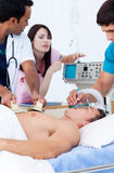 Ambitious medical team resuscitating a patient Stock Images
