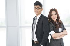 Ambitious team. Portrait of business duo with ambitious look and confident smiles stock images
