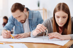 Ambitious team of architects drawing the blueprint together Royalty Free Stock Photography