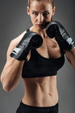 Ambitious woman posing with boxing gloves Royalty Free Stock Photos