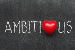 Ambitious. Word handwritten on blackboard with heart symbol instead of O stock photo
