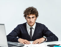 Ambitious young businessman looking at camera with serious look Stock Photography