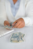 Ambitious young woman counting cash money Stock Photo