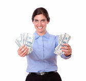 Ambitious young woman holding cash dollars Stock Photography