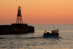 Amble Harbour at dawn stock images