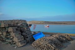 Amble harbour in northumberland UK. Amble Harbour Crab Pots on the quayside,  Northumberland County UK Stock Photography