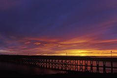 Amble Harbour at Sunset. Amble Harbour and pier at sunset Royalty Free Stock Photo