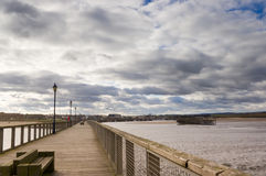 Amble harbour and village. Viewed from the pier Stock Photo