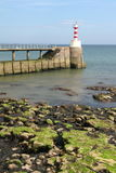 Amble Lighthouse. The harbour entrance, Taken in the Amble Village harbour, with the amble lighthouse Stock Photography