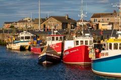 Fishing boats moored in Amble, Norhumberland, UK. Amble, Northumberland/ UK - July 31, 2018: Fishing boats moored in Amble, Norhumberland, UK on a calm evening royalty free stock photo