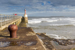 Amble pier. With Coquet island on the horizon Royalty Free Stock Photography