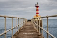 The Amble Pier Lighthouse, England, UK. The Pier Lighthouse in Amble in Northumberland, England, UK, seen from the South Pier stock photo