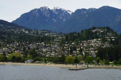 Ambleside Beach and Park Royal, West Vancouver, BC  with mountains on the background.  Stock Images