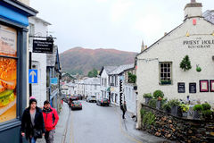 Ambleside, Cumbria. Ambleside, Cumbria, UK. January 28, 2017.  Church street where William Wordsworth was employed as a stamp collector and with Loughrigg fell Royalty Free Stock Images