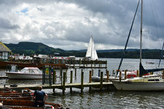 Ambleside. Harbor at Ambleside in Lake district  overlooking Windermere Lake. Rowboats, sailboats and cruise boats at the pier of an english resort Stock Photography