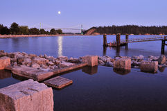 Ambleside park in west vancouver. With lions gate bridge in background stock image