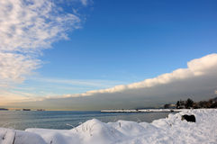 Ambleside park in West Vancouver near Park Royal. Snow at Ambleside park in West Vancouver under a blanket cloud formation Royalty Free Stock Photography