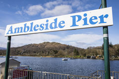 Ambleside Pier in the Lake District. The sign for Ambleside Pier on Lake Windermere in the Lake District, UK Royalty Free Stock Photography