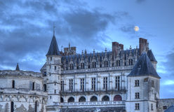 Amboise Castle with The Moon Above. Evening image of the Amboise Castle with The Moon above on a cloudy sky. Château d'Amboise is one of the famous Chateaux on Stock Photos