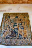 AMBOISE, FRANCE - CIRCA JUNE 2014: Beautiful tapestry on the wall of chateau. AMBOISE, FRANCE - CIRCA JUNE 2014: Close up stunning interior decoration of stock photos