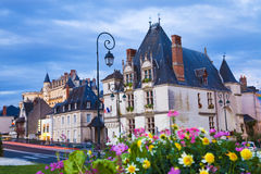 Amboise town and Chateau at dusk. Exterior view of Amboise houses with the Chateau as background. France Series Stock Photography