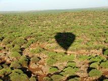 Amboseli. Shadow of hot air balloon, Amboseli National Park, Kenya Royalty Free Stock Image