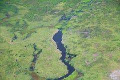 Amboseli de las nubes que miran sobre elefantes Imagen de archivo libre de regalías