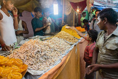Ambubachi Mela 2014. A boy buying his favorite sweets  at Maa Kamakhaya Temple atop Nilachal Hills in Guwahati, the capital city of India's northeastern state Stock Photography